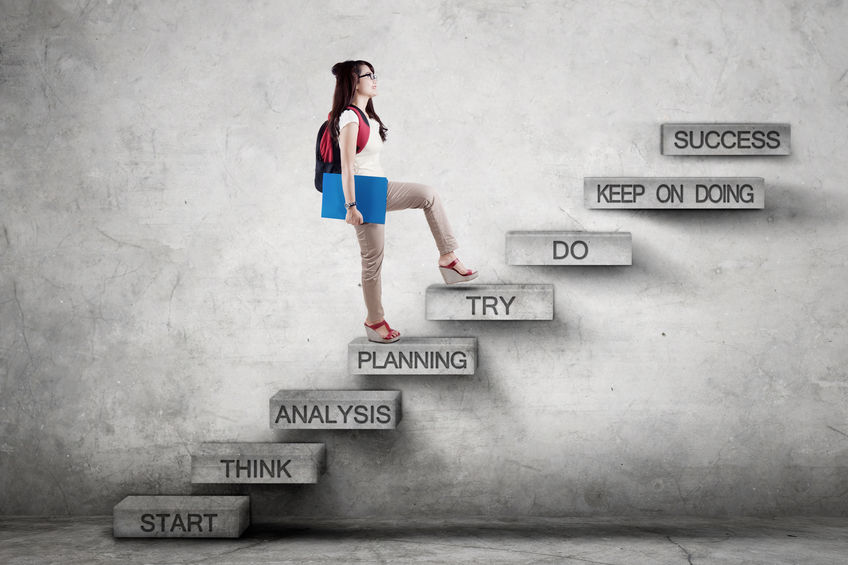 Student walks on stairs with strategy plan